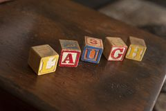 Old Vintage Toy Block Letters spell word Laugh stock photos