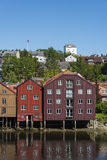 Colorful old warehouses by river Nidelv Trondheim Royalty Free Stock Images