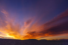 Colorful orange and blue dramatic sky with clouds. Stock Photo