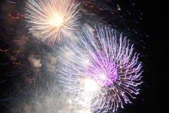 Colorful orange, cream and purple multi-colored fireworks. Stock Photography