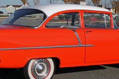Colorful orange fifties car Royalty Free Stock Images