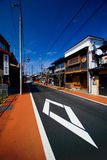 Colorful orange footpath and black street road in Takayama royalty free stock photography