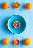 Colorful Orange fruits over a light blue painted wood table Royalty Free Stock Photography