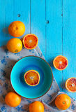 Colorful Orange fruits over a light blue painted wood table Stock Images