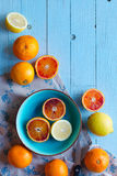 Colorful Orange fruits over a light blue painted wood table Royalty Free Stock Photo