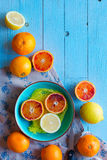 Colorful Orange fruits over a light blue painted wood table Stock Photography