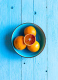 Colorful Orange fruits over a light blue painted wood table Royalty Free Stock Images