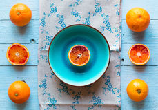 Colorful Orange fruits over a light blue painted wood table Stock Photo