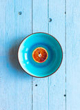 Colorful Orange fruits over a light blue painted wood table Stock Photos