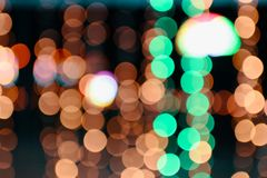 Colorful orange and green bokeh defocused on background. Colorful orange and green bokeh defocused on night background stock photos