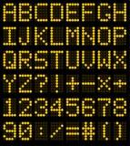 Colorful orange LED set against. Scoreboard digital font Stock Image