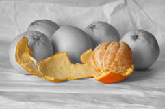 Colorful oranges and gray ones. Digital post production, concept: Live your life, don't let it just roll by Stock Photo