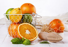 Colorful oranges, lemons and limes over white wooden background Royalty Free Stock Photo