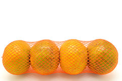 Colorful oranges in a red plastic net Royalty Free Stock Image