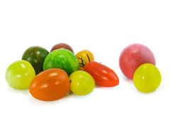 Colorful organic tomatoes. Bunch of multi-colored organic tomatoes isolated on white Stock Photos