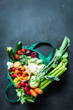 Colorful organic vegetables in green eco shopping bag Royalty Free Stock Images