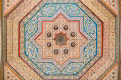 Colorful oriental Ceiling fragment inside the Bahia palace Royalty Free Stock Photo