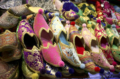 Colorful oriental shoes. Selling colorful oriental shoes at the Grand Bazaar in Istanbul Stock Photos