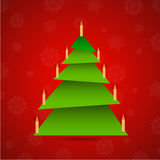 Colorful origami christmas tree with candles Royalty Free Stock Images