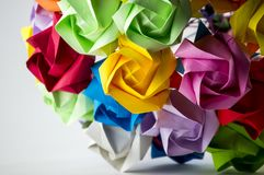 Colorful Origami flower bouquet on white background. Origami art composition. Artistic blur. Flower pattern stock photo