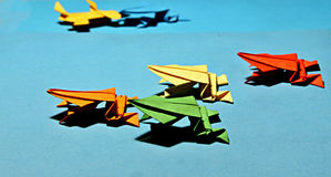 Colorful origami frogs Stock Photos