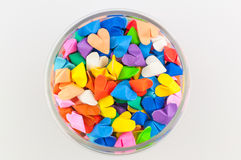 Colorful origami heart in glass. On white background Stock Images