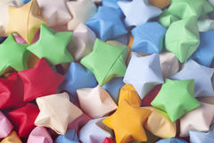 Colorful origami lucky stars background Royalty Free Stock Image
