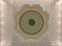 Colorful ornament of the inside of the dome of a Muslim mosque. View of the inside of the dome with a Muslim mosque ornament stock image