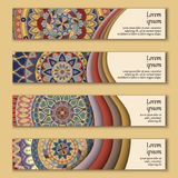 Colorful ornamental ethnic banner set. Templates with wavy elements and tribal mandala. Royalty Free Stock Photography