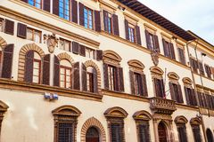 Colorful ornamental exterior of building. From below view of bright old building facade with ornamental design and colorful windows, Italy stock images