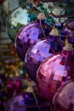 Colorful ornaments. Row of colorful disco ball ornaments on display at the store Stock Image