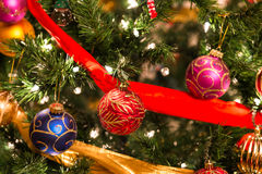 Colorful Ornaments On a Christmas Tree. These are colorful ornaments on a Christmas tree Royalty Free Stock Images