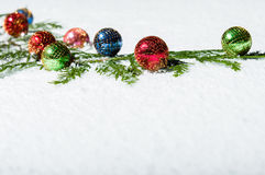 Colorful ornaments in snow with space Royalty Free Stock Images