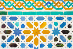 Colorful ornate pattern of moorish tile decorations in alhambra Stock Photography