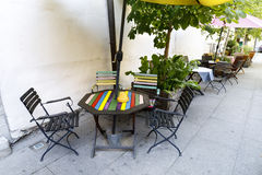Outdoor cafe with a colorful table Stock Images