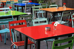 Colorful outdoor cafe tables. Royalty Free Stock Image