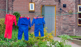 Colorful overalls on the clothesline of a farm Royalty Free Stock Photo