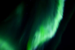 Colorful overhead aurora. Overhead band of northern lights in the night sky Royalty Free Stock Images