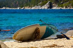 Colorful paddle boards on the beach. Summer vacation and water s Stock Image