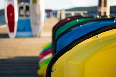 Colorful paddle boats on a dock stock photo