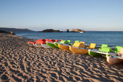 Colorful paddle boats on seashore. A lovely view from the beach in Crete, Greece Stock Image