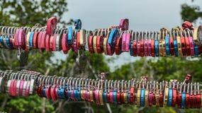 Colorful padlocks on Sky Bridge railing stock images