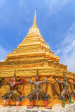 Colorful pagodas. The characters in literature Thailand carrying giant golden pagoda in the temple of the Emerald Buddha , also known as the Temple of the Royalty Free Stock Photography