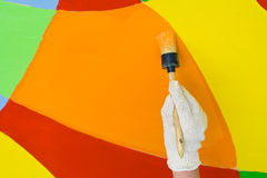 Colorful paint. With a paintbrush Royalty Free Stock Photography