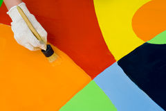 Colorful paint. Background of colorful paint with a paintbrush Stock Photography