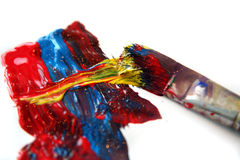 Colorful paint and brush Stock Image