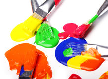 Colorful paint and brushes Royalty Free Stock Photography