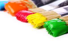 Colorful paint and brushes Royalty Free Stock Image