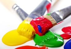 Colorful paint and brushes Stock Photography