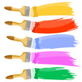 Colorful paint brushes. Leaving a horizontal trail Stock Photos